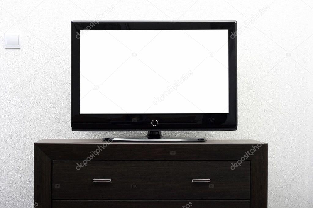 Blank Tv Bildschirm Auf Braun Kommode Gegen Weisse Wand Stockfoto