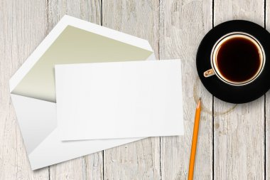 blank letter with envelope and coffee cup on the table