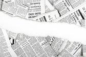 Fényképek régi újságok hasogatott