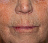 Close-up view of a old womans mouth
