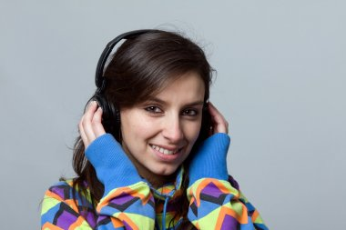 Young beautiful woman listen music with headphones