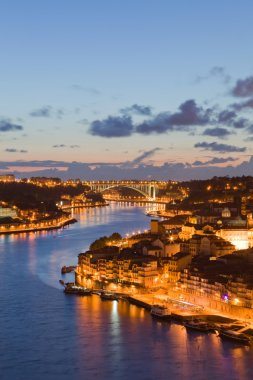 Panorama old city Porto at river Duoro,with Port transporting bo