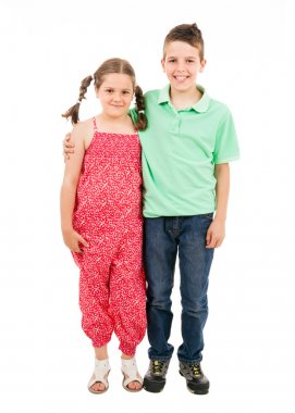 Full body portrait of two children standing over white backgroun