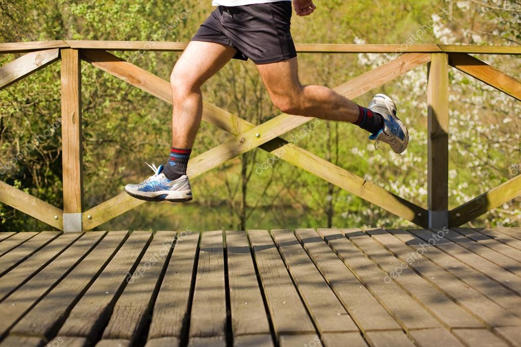 Young man jumping at the park