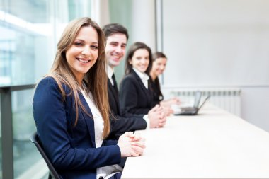 Group of business smiling at the office lined up