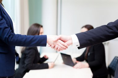 Business handshake at the office with bussiness