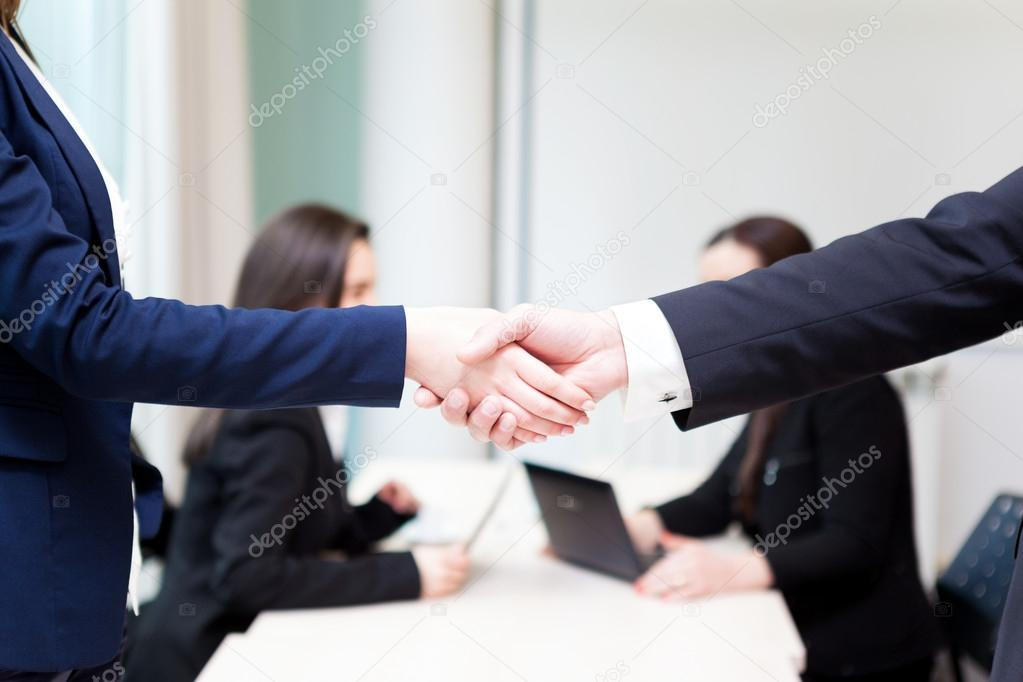 business handshake at the office with bussiness stock photo