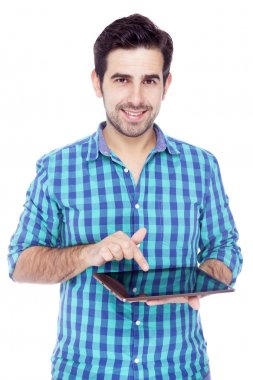Handsome smiling man using a tablet computer, isolated over a wh