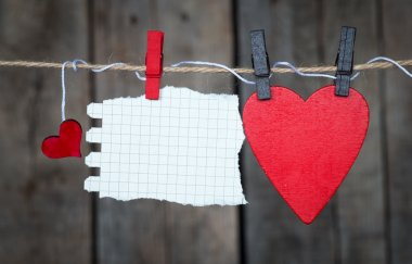 Blank instant paper and small red paper hearts