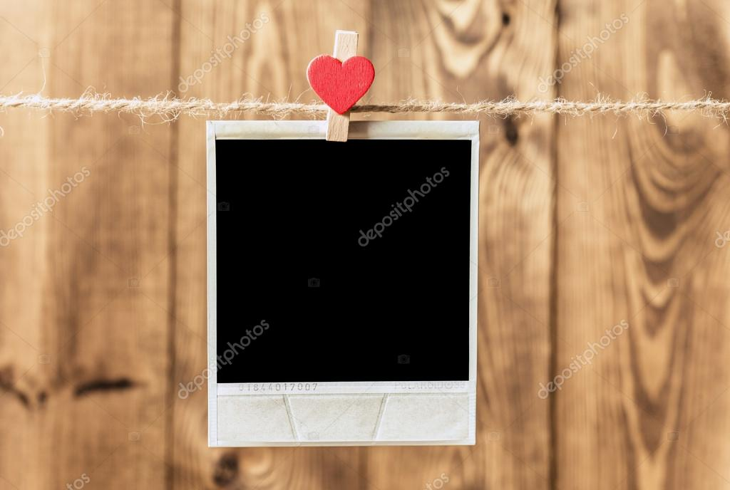 Old picture frame hanging on clothesline — Stock Photo © roobcio ...