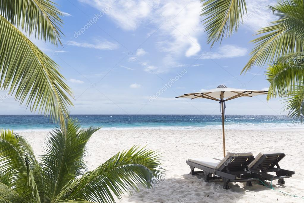 Beach chair at sunny coast. Seychelles.