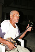 Old Man Playing Sanshin Guitar, Okinawa, Japan