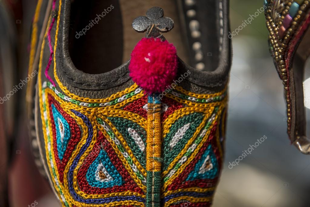 4525ea9fe4d3 Colorful Indian style ladies slippers on a display — Photo by jacek kadaj
