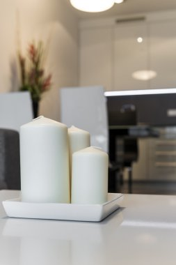Three Candles in modern apartment