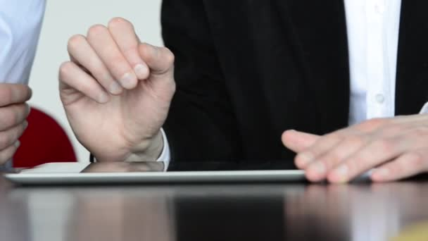 Two man hands pressing on screen digital tablet