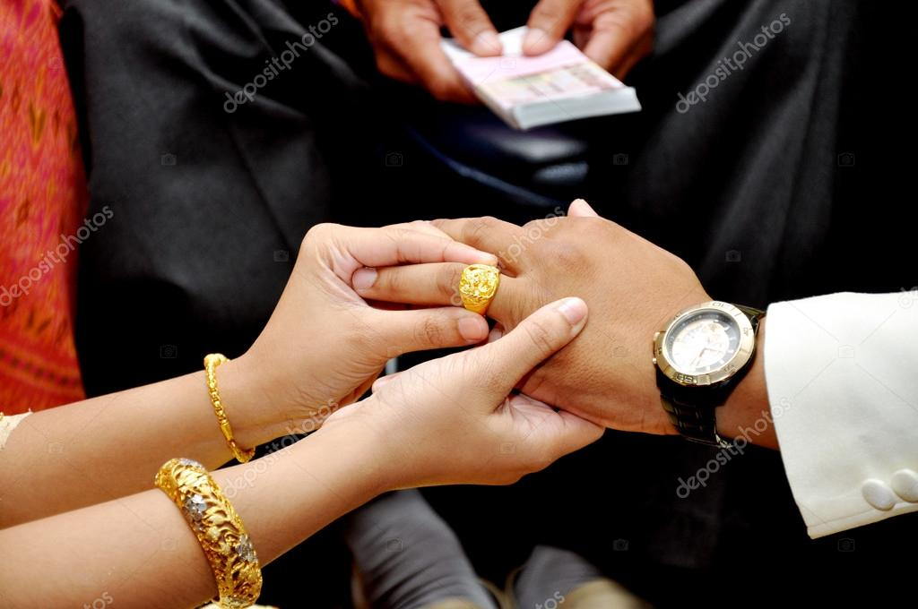 Bride wears wedding gold ring groom — Stock Photo © bigjom #13887983