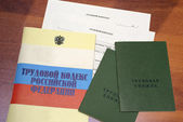 Fotografie Russian labour code and blank form of a employment agreement with work record books