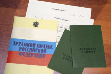 Russian labour code and blank form of a employment agreement with work record books