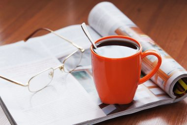 Cup of coffee and magazine