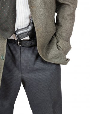 Man with a gun in his belt