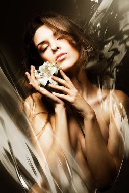 Sexy woman with flowers and water