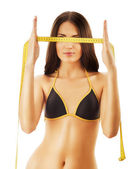 Photo slimming woman with measure before eyes