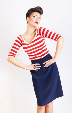 interesting cute woman in striped t-shirt and skirt