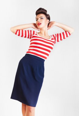 interesting dreaming woman in striped t-shirt