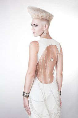 futuristic beautiful woman in dress with creative hairstyle