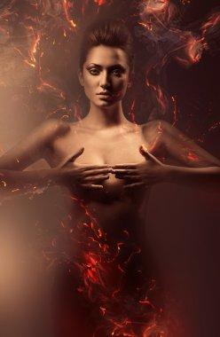 sensual nude woman in fire