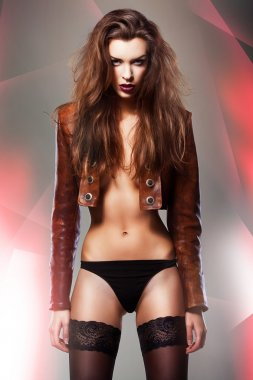 Pretty erotic woman in jacket and panties