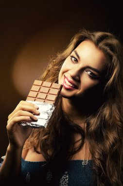 smiling woman with big chocolate bar
