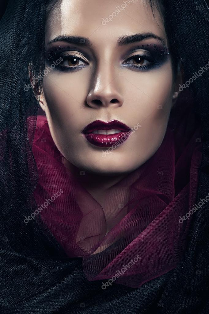 Sexy Passionate Woman In Black And Red Hood Stock Photo