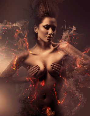 Burning erotic sexy beautiful woman in dirty mist