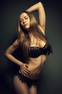 attractive hot woman in dark lingerie