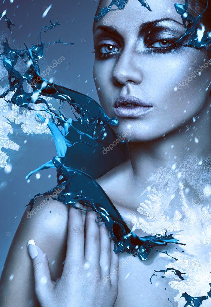 Close up portrait of winter woman with blue splash