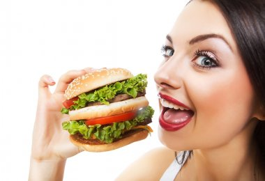 Funny girl eating hamburger