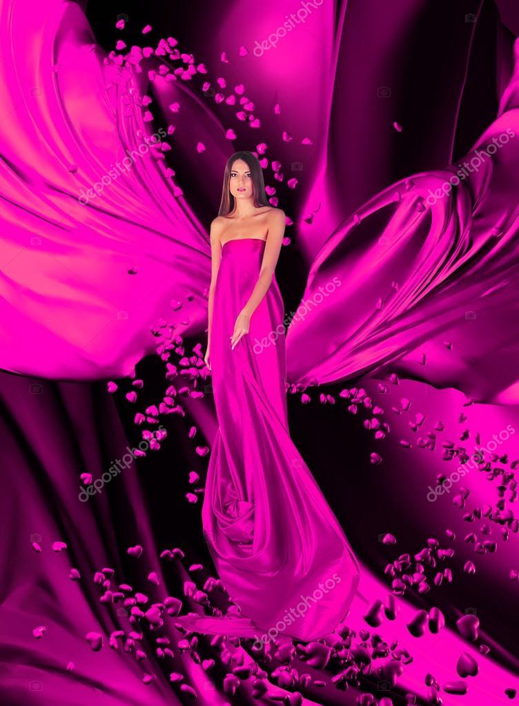 diosa del amor en vestido largo rojo con el magnífico pelo largo ...