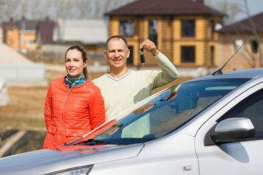 Happy family holds   keys to  car