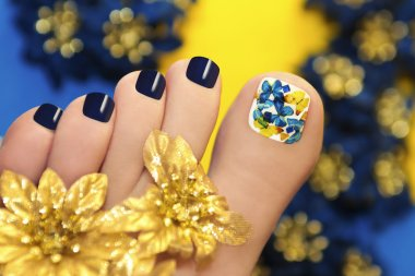 Blue pedicure with butterflies.