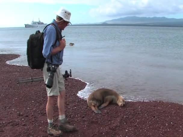 Man looking at sealion on the Galapagos Islands