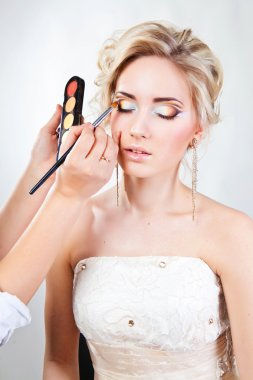 Applying wedding makeup