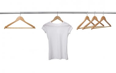 white t shirt on cloth hangers