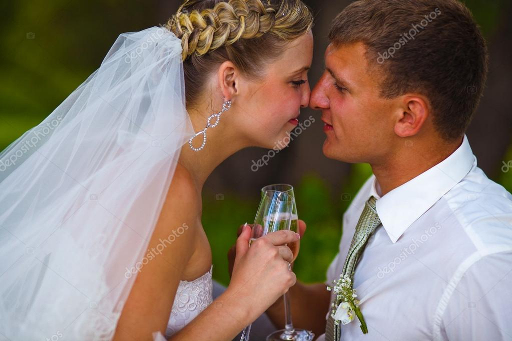 Bride and groom at wedding couple holding glass of touching and