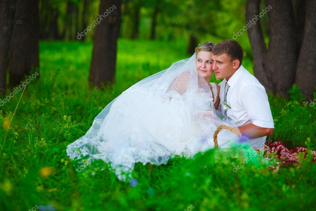 couple at wedding newlyweds a picnic in forest glade, bride groo
