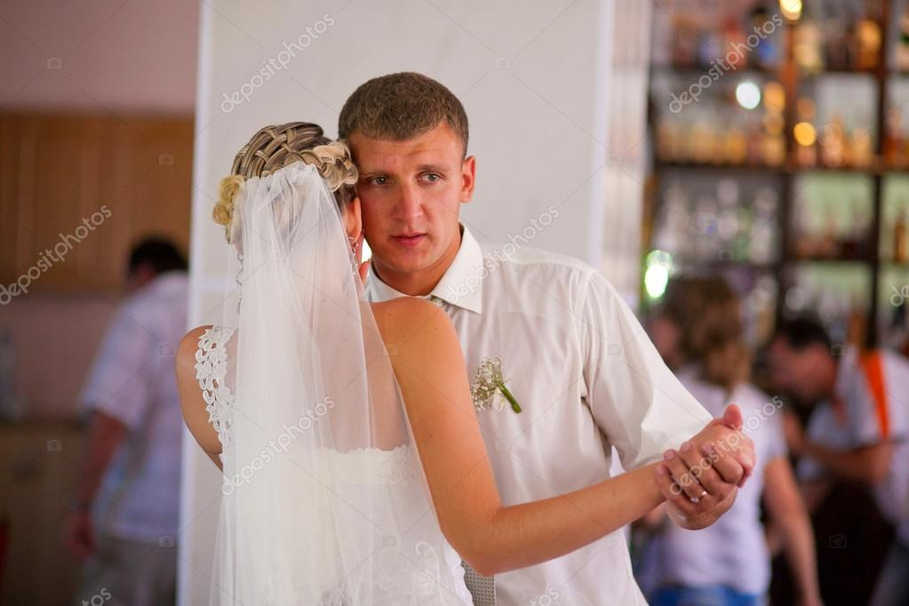 Bride and groom dancing at wedding couple, sad crying in hall