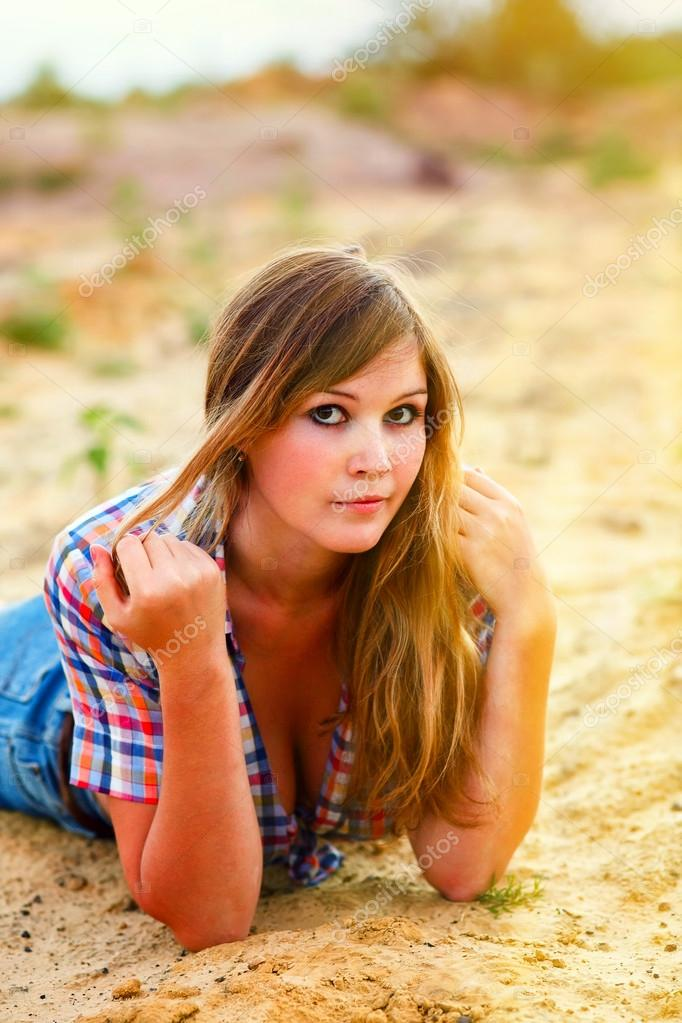 sunlight blonde woman model with large breasts plaid shirt and j