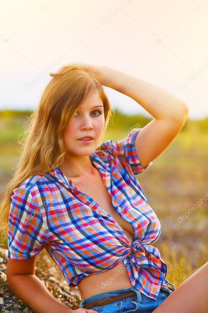 sunlight blonde woman with large portrait breasts plaid shirt an