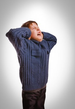 Gray teenager boy child covered his ears screaming opened