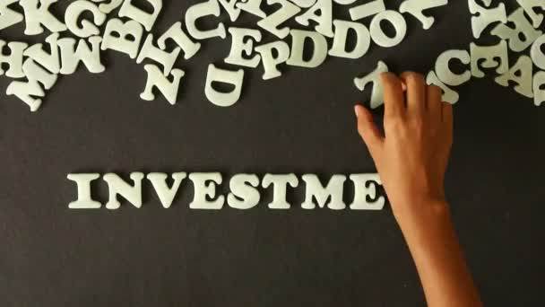 A person spelling investment opportunities